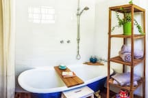A deep luxurious bath with rain shower head, quality eco shampoo, conditioner and body wash, non-toxic organic hemp shower curtain and solid bath caddy for your drink, and a good book.