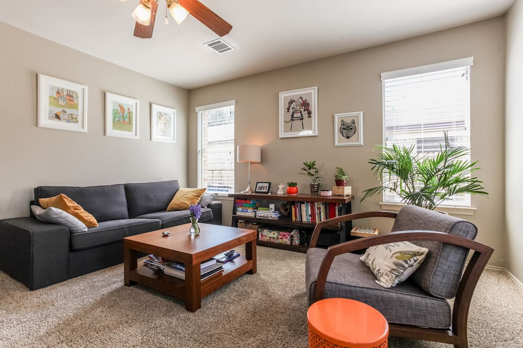 Family room with good library and comfy couch.