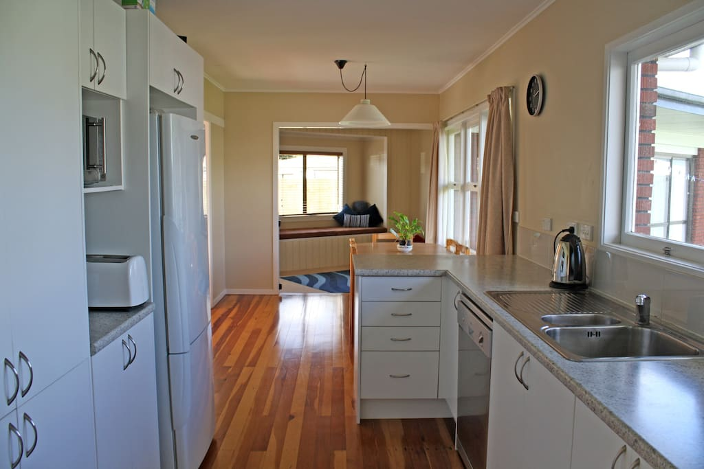 Fully equipped and modern open plan kitchen with beautiful hard wood floors