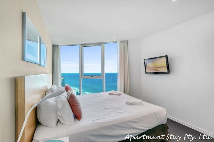 EMERALD COAST - Master Bedroom has King Bed with large ensuite and large walk in wardrobe room. Enjoy glorious ocean views and skyscape.