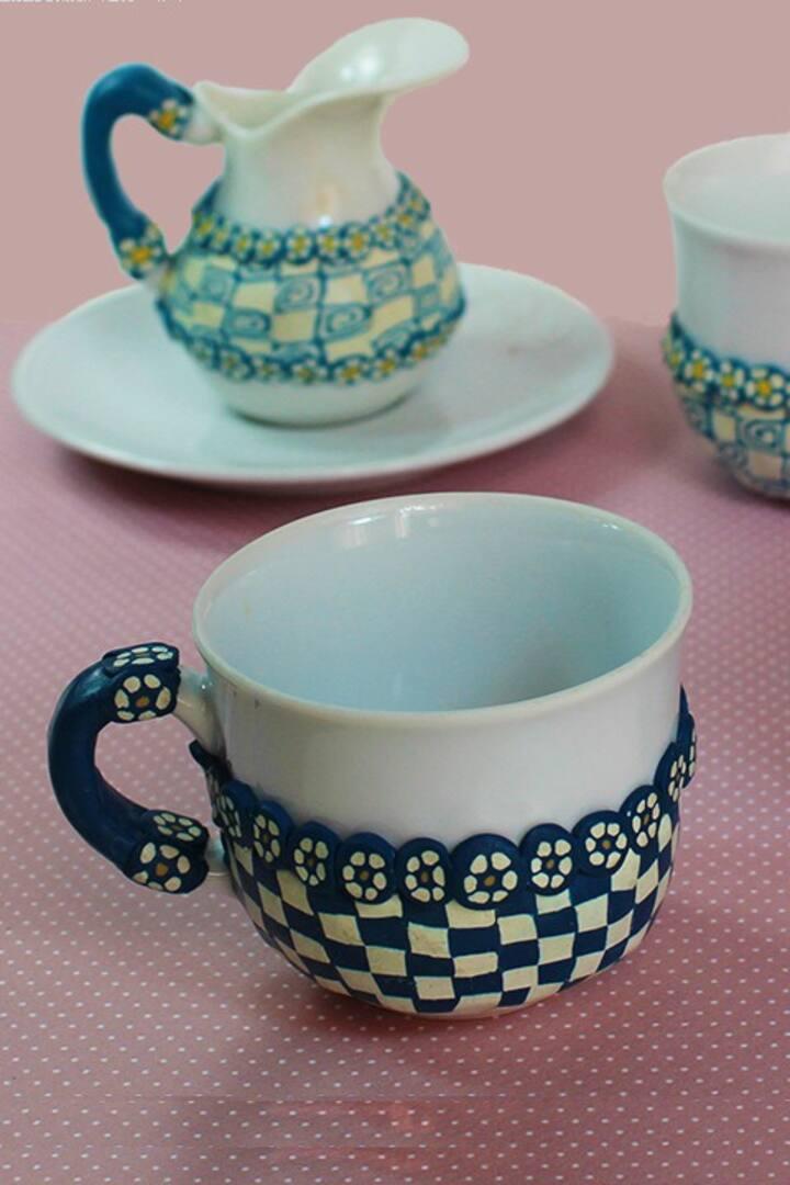 Coffee mug with millefiori decorations