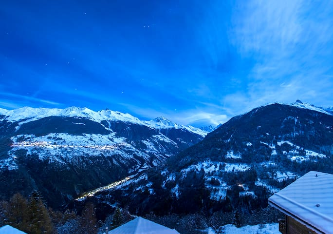 Admire the view of Val D'Herens as the sun goes down