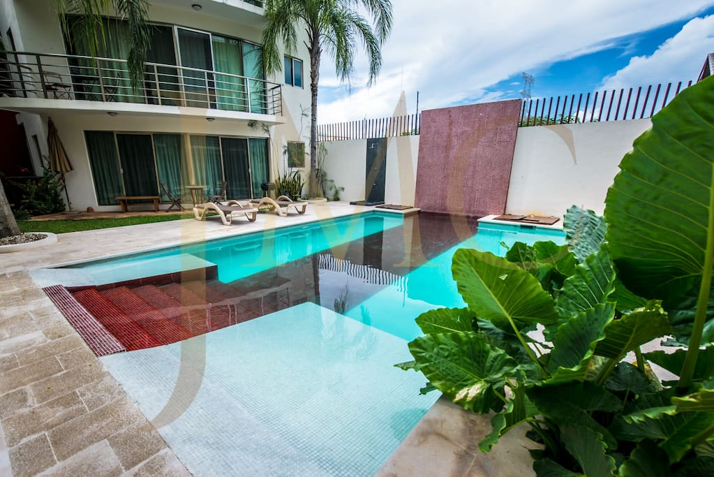 "Cool off at night in our buildings refreshing splash pool... just steps from your ""Caribbean home."""