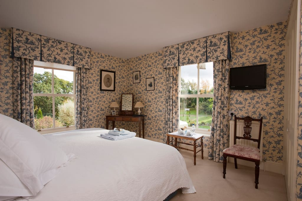 Blue room with garden views and private bathroom adjacent