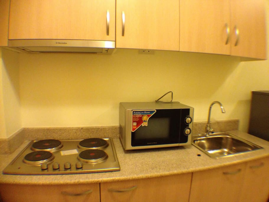 Electrical stove, microwave and refrigerator available for use. Utensils included.