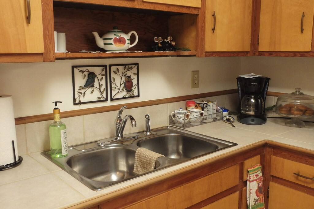 Kitchen includes dishwasher, full-size refrigerator and washer/dryer.