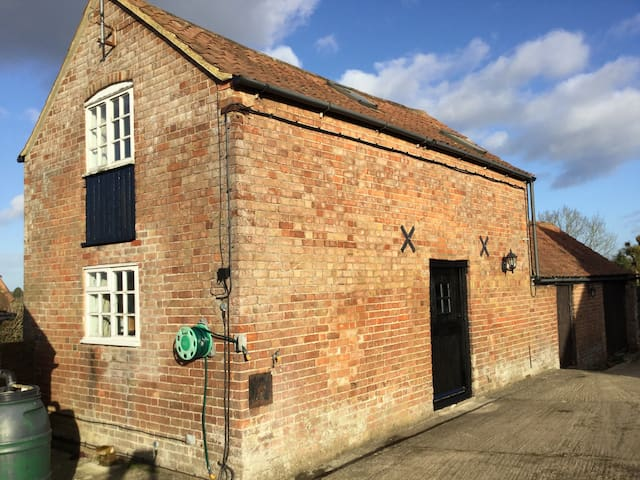 The Coach House front view, windows to the back and sides upstairs with views over fields.