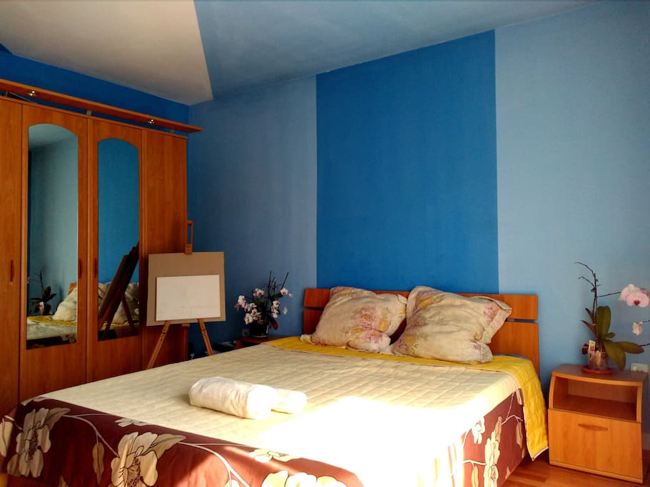 Comfy, big and well lit room, has a desk and private bathroom. There is also a balcony.