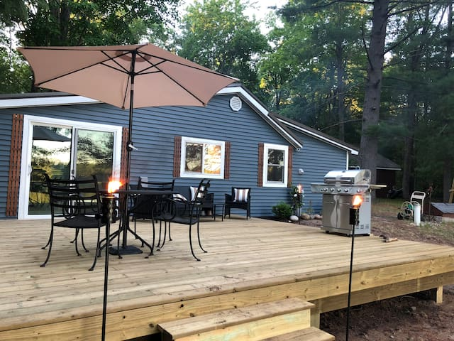Deck now has a railing.  Propane gas grill provided.  Deck has a table that seats 4 and conversation seating for 4.