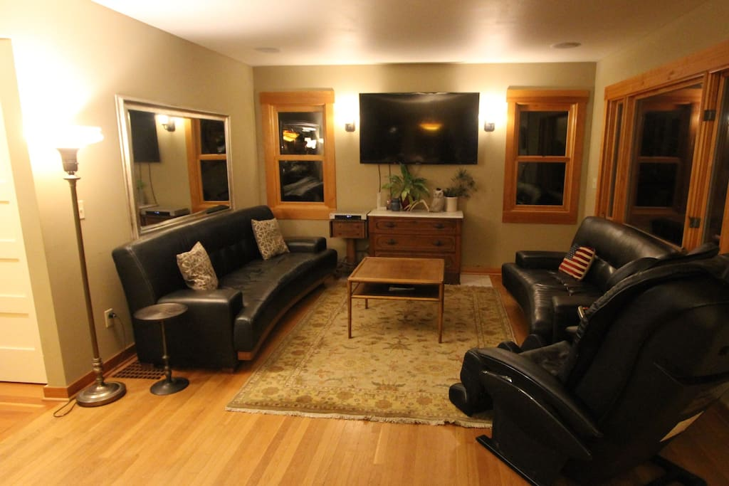 "Large family room with 55"" LCD tv and massage chair"