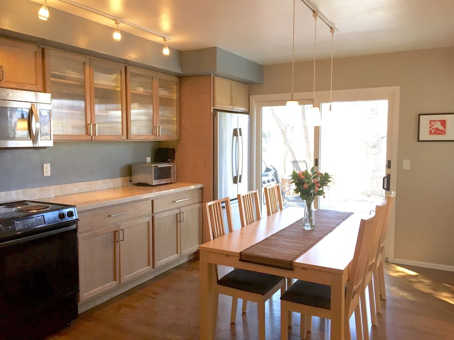 Newly renovated custom kitchen with eat in dining.