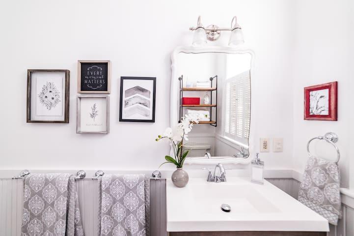 Bathroom w/ historic clawfoot tub & shower combination.