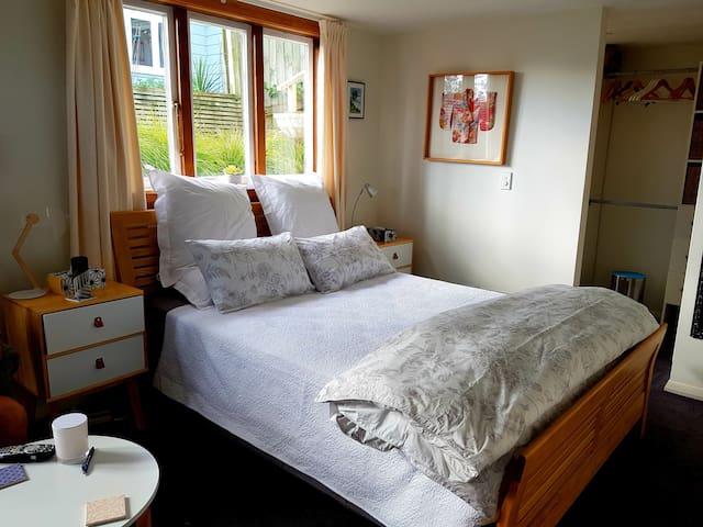 Comfortable queen bed with beautiful linen