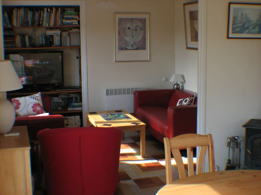 Lounge / Dining Area - Complete with UK television, air-conditioning (hot&cold), electric heater and wood burning stove.