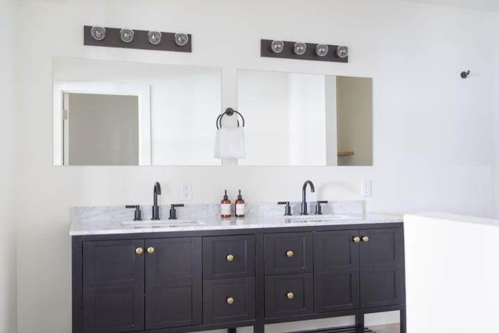 Double sinks, marble counter tops and large mirrors allow for ease of getting ready