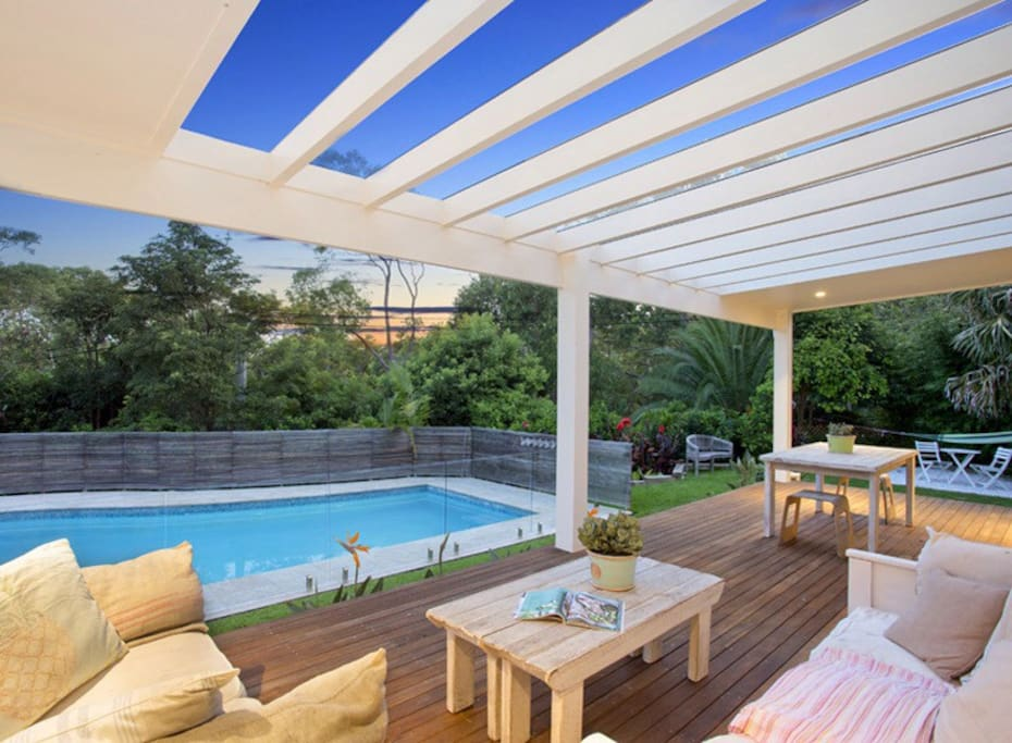 Large private entertaining deck overlooking heated pool