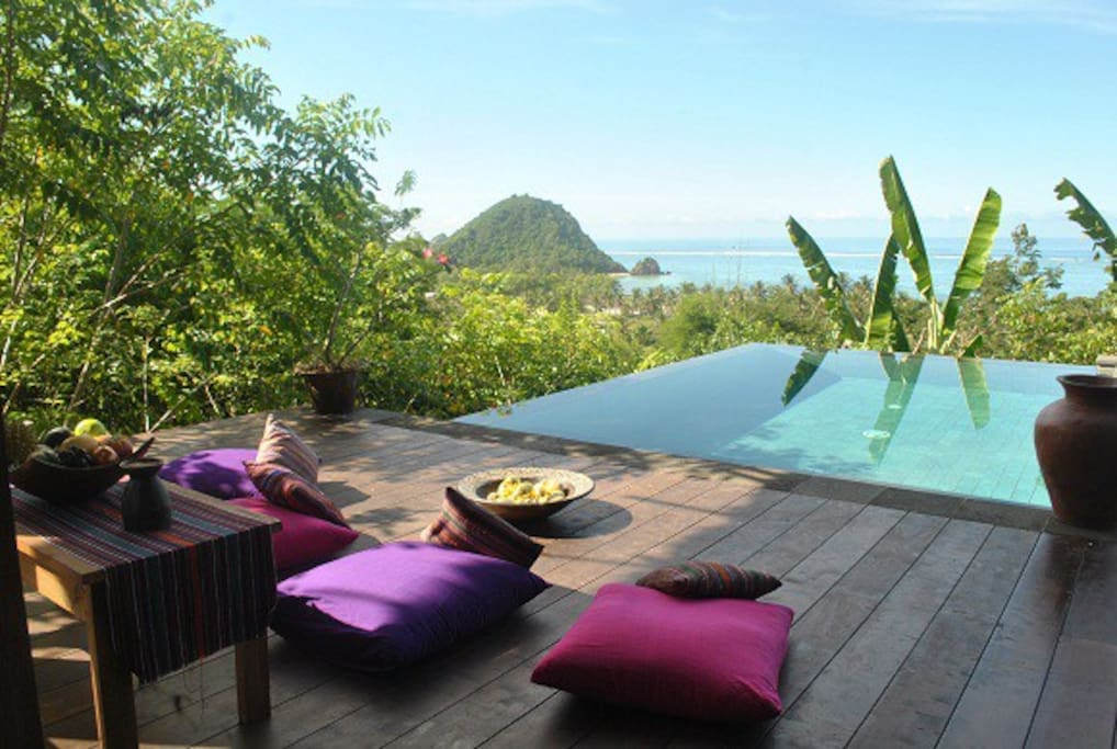 Relax on the terrace of the Master villa admiring the amazing view on Kuta Bay.