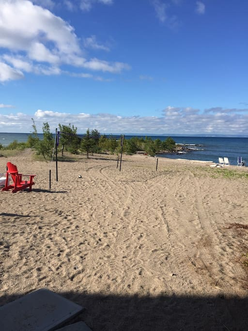 Sand Beach With Muskoks Chairs and Reclining beach Chairs.What s view!