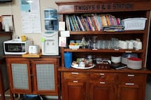 kitchen cabinet for guest, filtered rain water. Use of microwave, gas stove , pots & pans , cutlery, glasses , wine glasses & more.