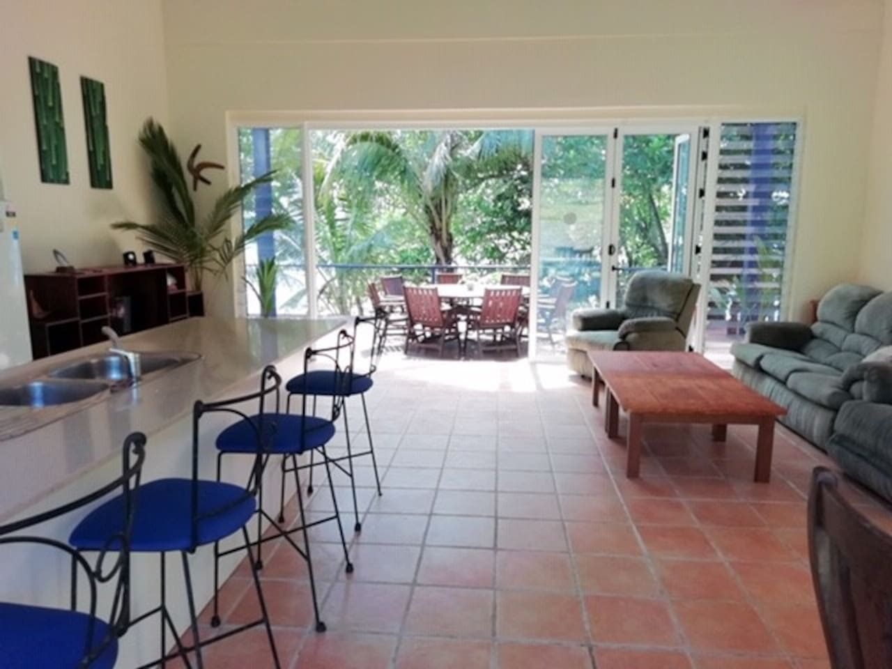 Spacious open plan living and entertainment deck -Australian Satellite TV and DVD