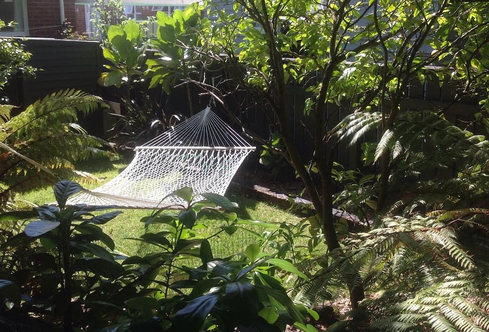 Relax on the hammock in our garden in warmer months.