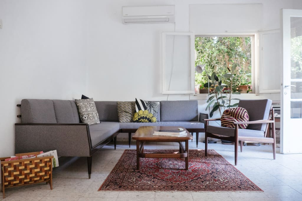 Our mid-century living room is attached to our balcony which means you get a cool afternoon breeze even on a hot summer day