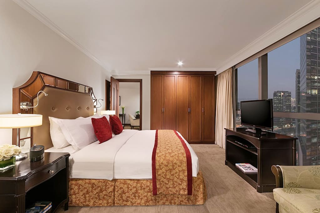 The bedroom has a king and twin size beds with television and a private toilet and bath with amenities.