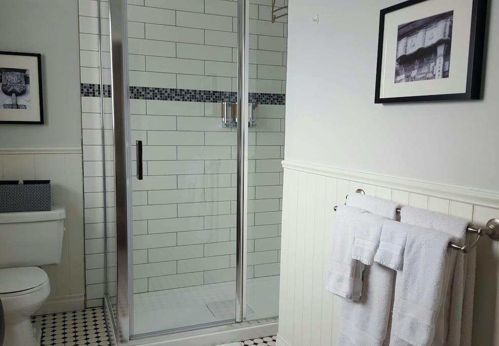 En-suite bathroom with large glass shower.