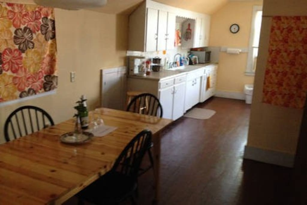 Shared dining area and fully equipped eat-in kitchen.