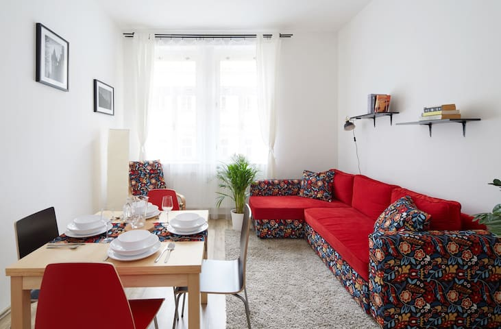 Our livig room - we have furnished it with wonderfully colourful folding sofa for two, folding dinner table for up to six a nice renovated rocking chair and charming pictures of Prague ;-)