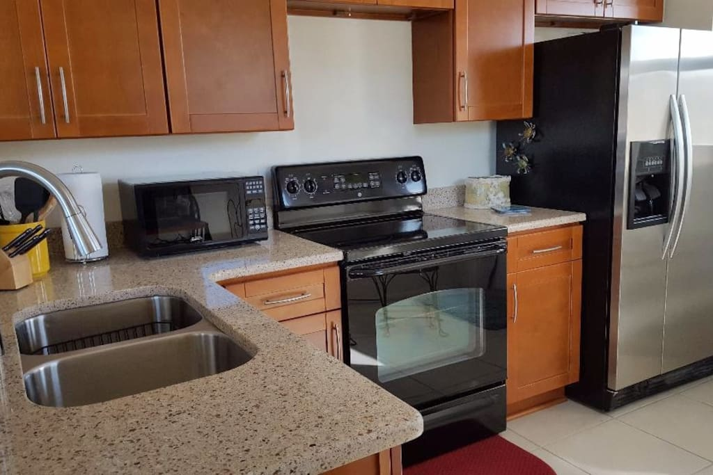 New kitchen cabinets and quartz counter tops. Kitchen is fully furnished with everything you need!