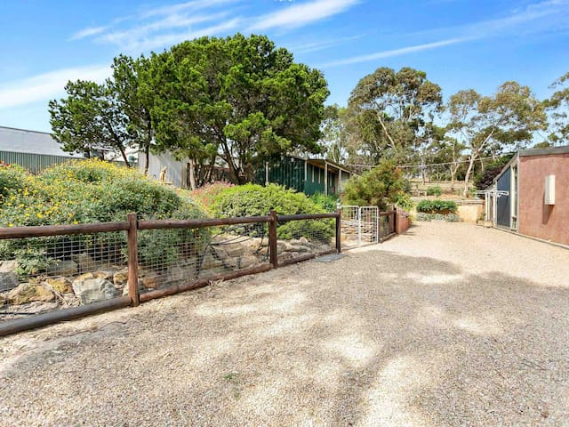 When you arrive, you can use the driveway area to unload and load your car before parking your car in the specified parking area for guests. The studio room is located behind the gate on the left, up a set of steps which leads to the front door.