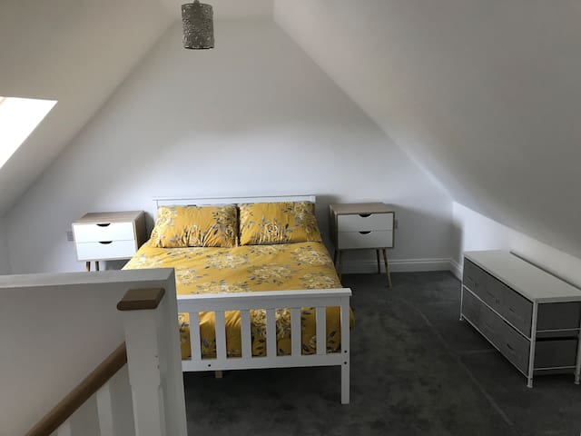 Master bedroom with double bed, please note the stairs enter this room and the twin room is located off to the right hand side at the top of the stairs
