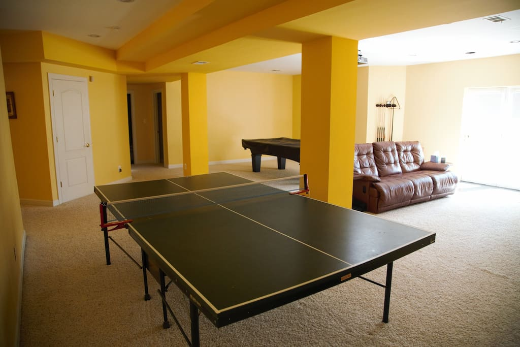 Rec room with ping pong table in foreground