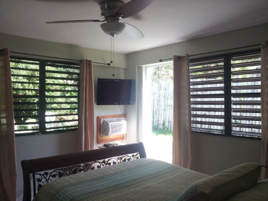 Looking out towards your private entrance and yard, many windows provide daylight & air flow