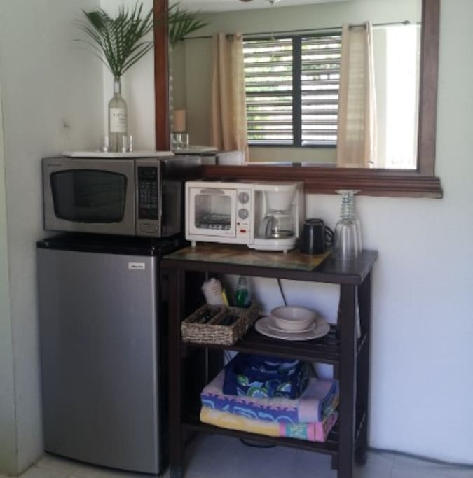 Amenities include beach towels, chairs & coolers, mini fridge, microwave, coffee maker & toaster oven, all dishes & utensils