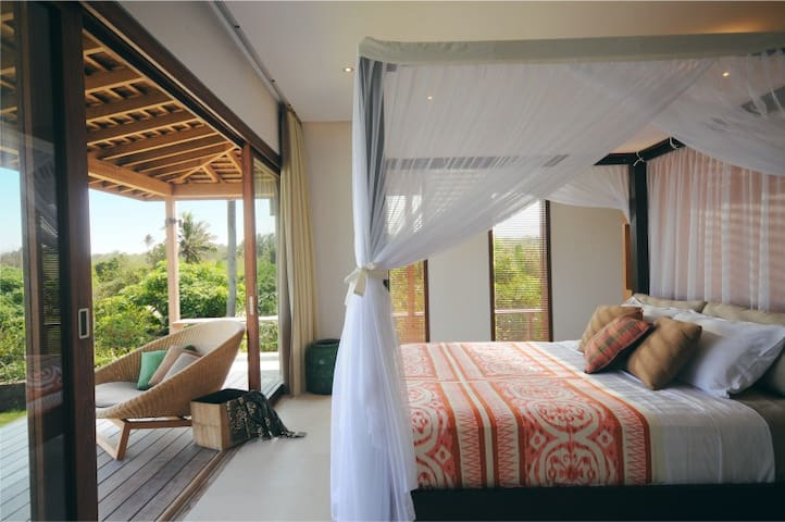 The second bedroom is just as romantic. It also has a double view: a wild Bali beach on one side, Bali rice fields on the other.