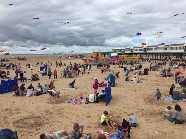 StAnnes Beach Donkeys, kites, ice cream & plenty of benches to sit & watch the fun.