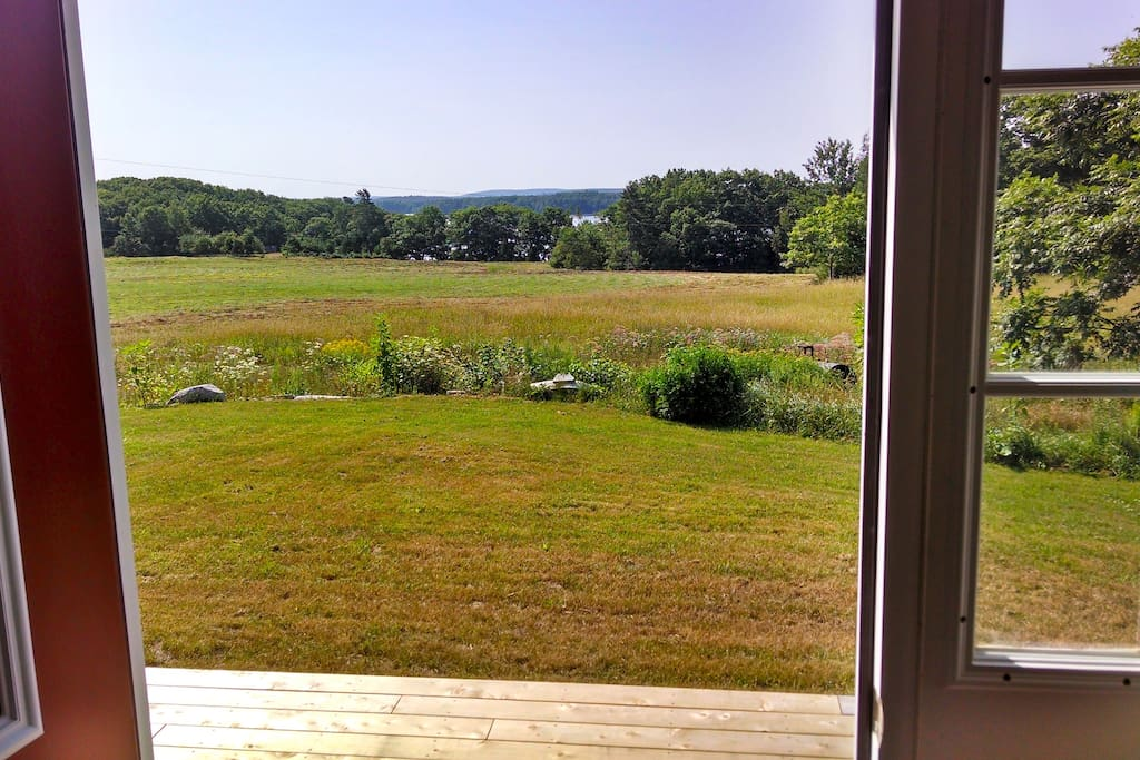 View out of the front door,  Bagaduce river in back ground.  We are in the middle of a seventy acre field.
