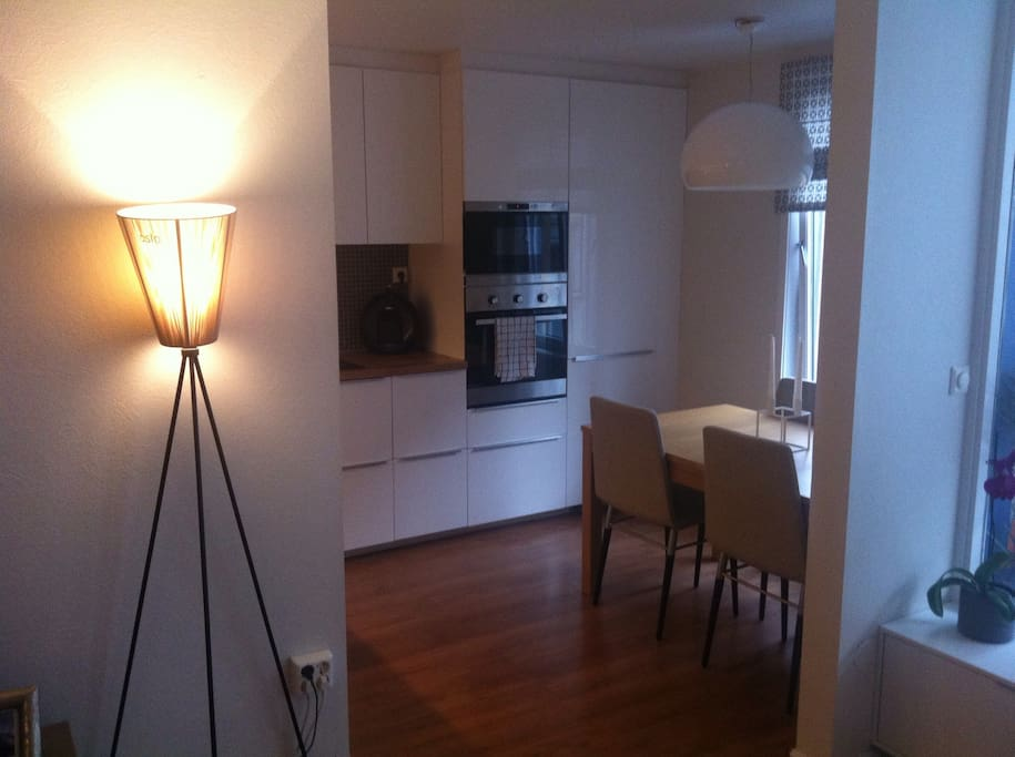 Brand new kitchen with table for wining and dining.