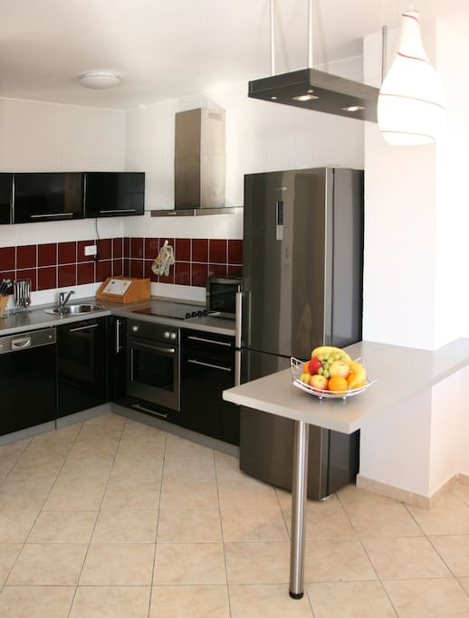 Kitchen with dish washer, fridge and freezer