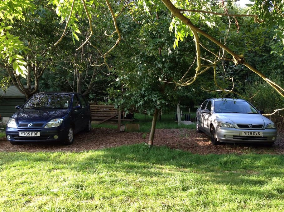 Three car parking spaces on bark chippings