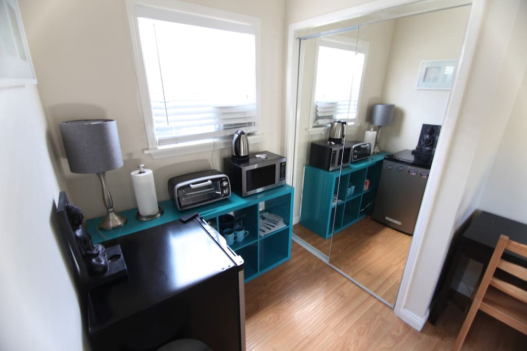 No Full Kitchen but does feature Mini Fridge, Microwave, Toaster Oven, and Plates / Bowls / Utensils