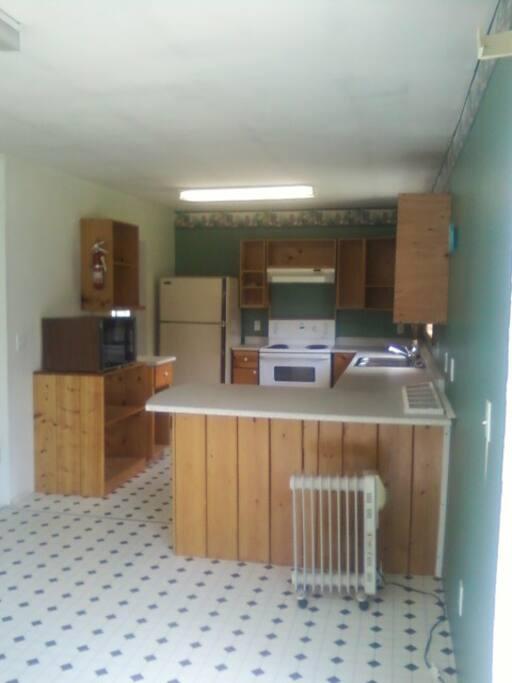 Dining,kitchen,laundry facilities left of fridge.