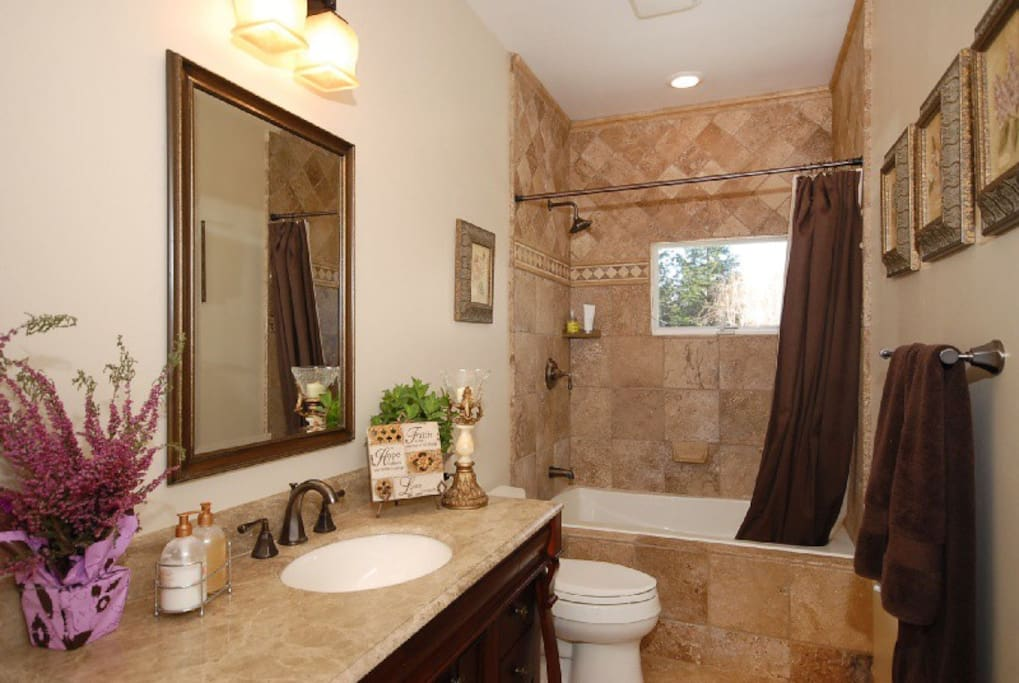 Private remodeled bathroom in guesthouse studio. Tile floor and shower. Granite countertop. Towels and toiletries provided.