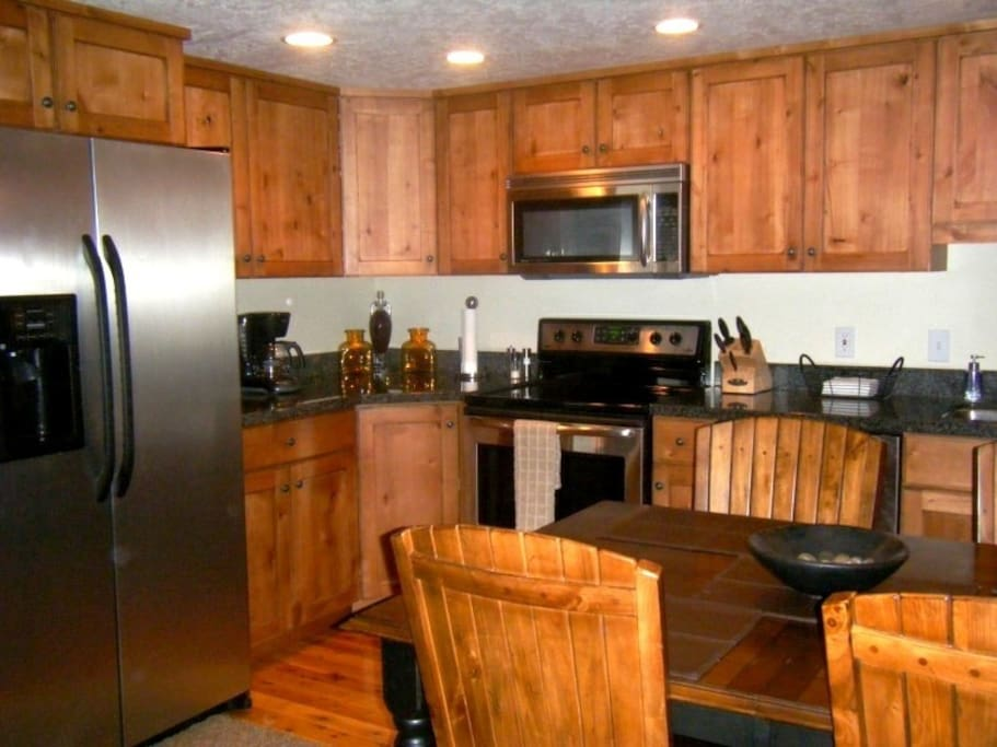 Knotty alder cabinets, granite countertops & stainless steel appliances