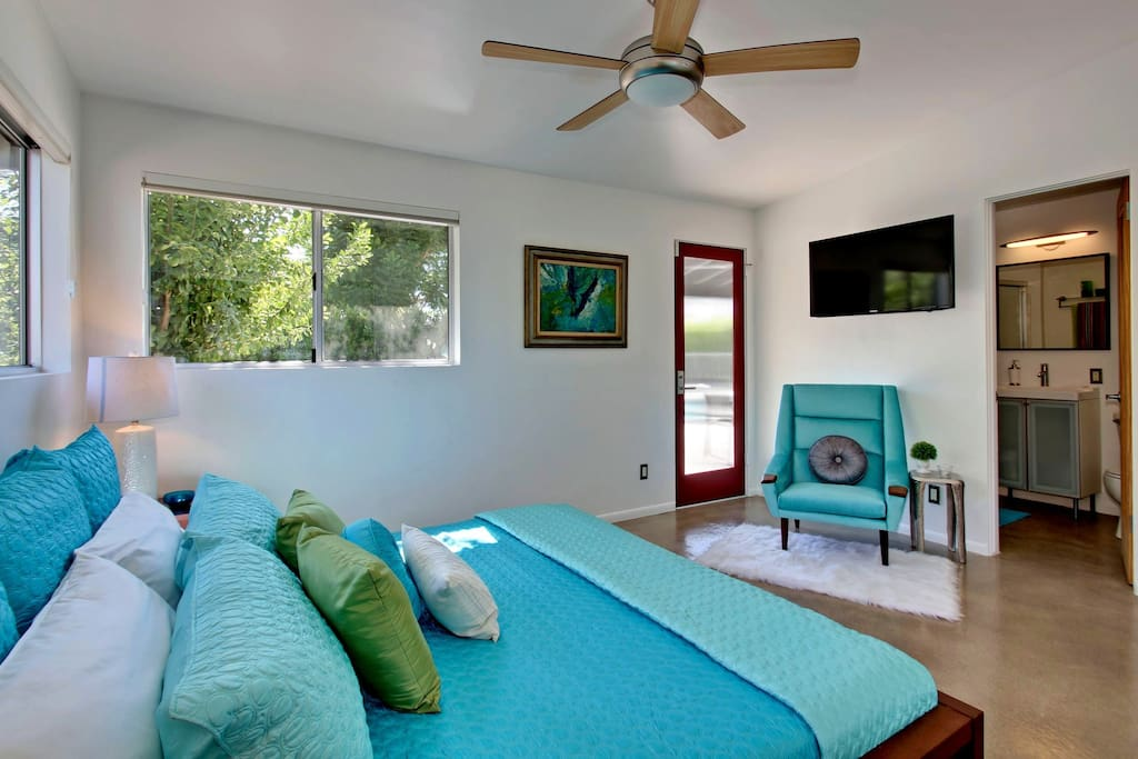Master Bedroom with private full bath, seating area, private access to pool area, and TV.