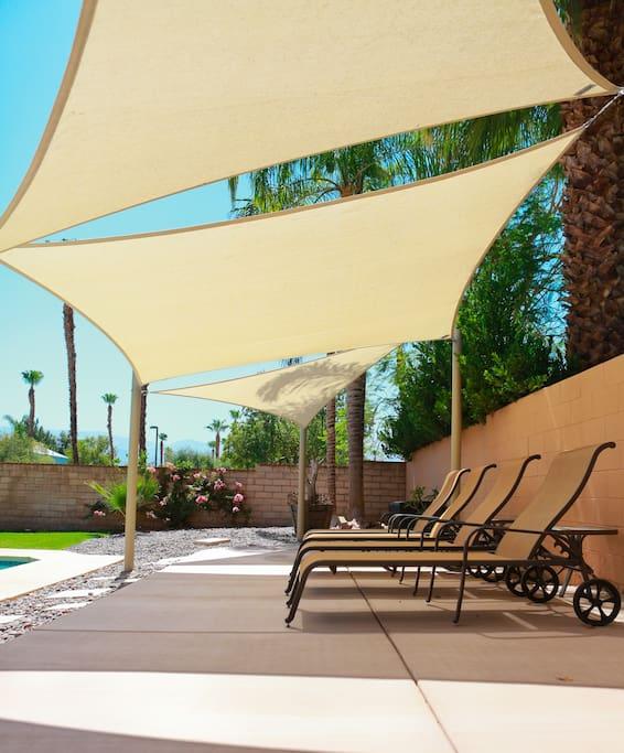 Pool with Custom Shade cabana sparking clean saline pool. Serviced 2x Per week.