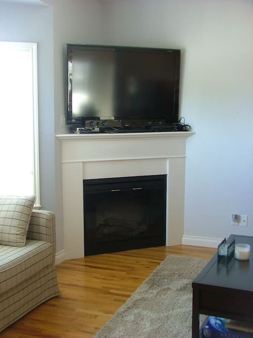 Gas fireplace and 52' TV complete with full cable and Netflix