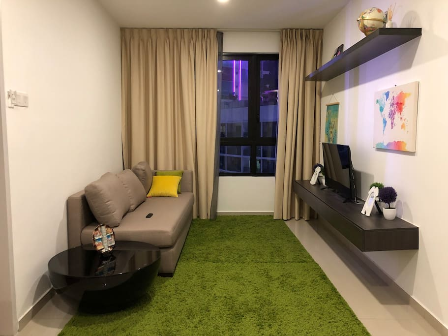 Spacious living hall with modern style furnishing, ample enough for chilling out